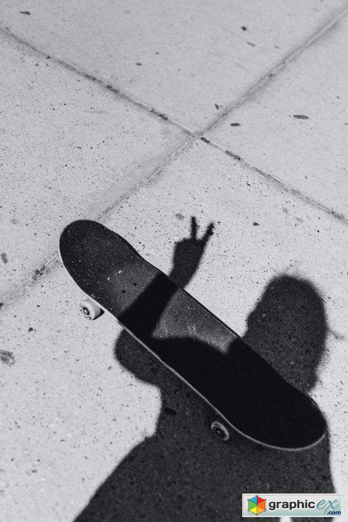 Shadow of a skateboarder on the concrete street
